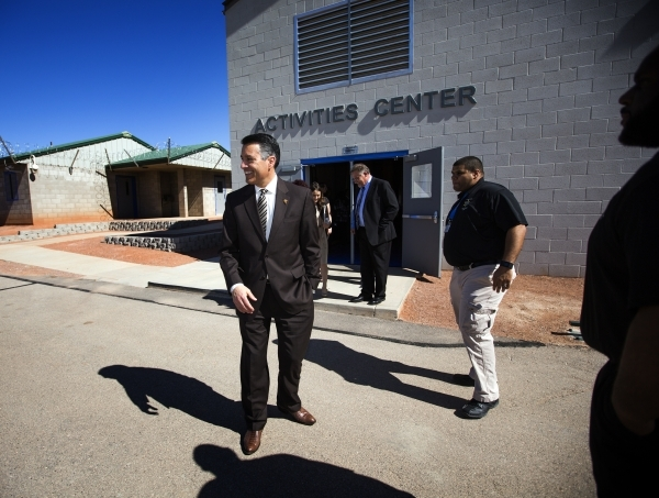 Nevada Governor Brian Sandoval stands in the yard of the   Summit View Youth Correctional Center, a 48-bed facility in North Las Vegas, on Friday, Feb.26, 2016. Jeff Scheid/Las Vegas Review-Journa ...