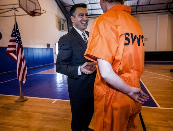 Nevada Governor Brian Sandoval shakes hands with a juvenile at  the Summit View Youth Correctional Center, a 48-bed facility in North Las Vegas, on Friday, Feb.26, 2016. Jeff Scheid/Las Vegas Revi ...