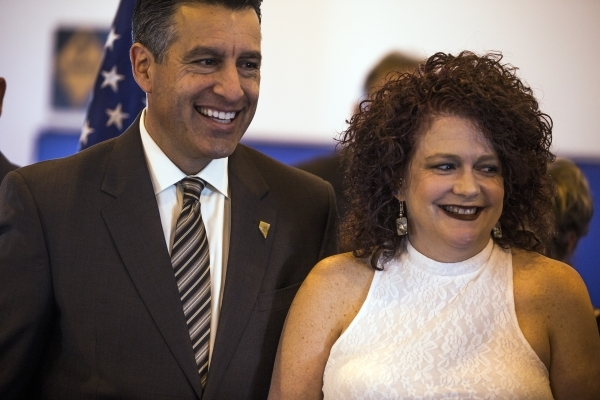 Nevada Governor Brian Sandoval and his wife Kathleen smile during the grand opening of Summit View Youth Correctional Center, a 48-bed facility in North Las Vegas, on Friday, Feb.26, 2016. Jeff Sc ...