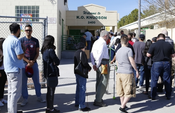 Democratic caucus-goers stay in line to sign in ahead of the party caucus at K.O. Knudson Middle School Saturday, Feb. 20, 2016, in Las Vegas. Bizuayehu Tesfaye/Las Vegas Review-Journal Follow @bi ...