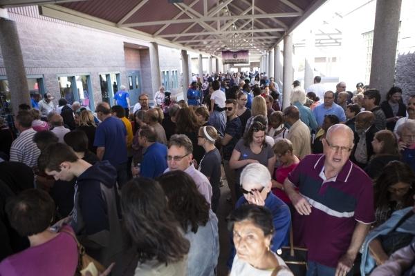 People line up to register for the Nevada caucus at Becker Middle School on Saturday, Feb. 20, 2016, in Las Vegas. Erik Verduzco/Las Vegas Review-Journal Follow @Erik_Verduzco