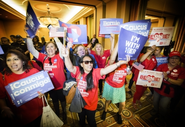 Hillary Clinton and Bernie Sanders  supporters rally  while attending the Nevada Democratic caucus at Caesars Palace on Saturday, Feb.20, 2016. Jeff Scheid/Las Vegas Review-Journal Follow @jlscheid
