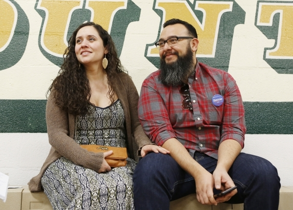 Jose Sotelo Jr., right, Democratic presidential candidate Sen. Bernie Sanders' (I-VT), supporter, and his fiancee Ashleigh Pacheco, undecided, participate in the Democratic Caucus at K.O. Kn ...