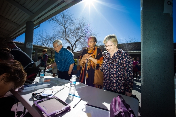 Democratic caucus-goers, from left, Seymour and Ellen Merill, and Gloria Newton, check in at Del Webb Middle School in Henderson on Saturday, Feb. 20, 2016. The three were supporters of Democratic ...