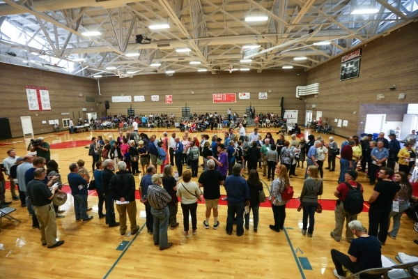 Democratic caucus-goers line up in support of presidential candidates Hillary Clinton and Sen. Bernie Sanders, I-Vt., at Del Webb Middle School in Henderson on Saturday, Feb. 20, 2016. Chase Steve ...