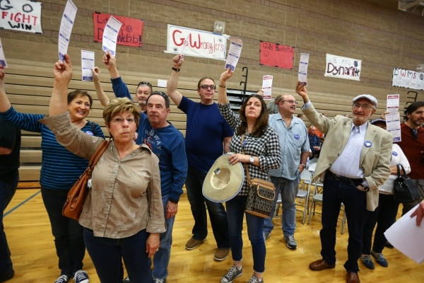 Supporters of Democratic presidential candidate Sen. Bernie Sanders, I-Vt., gather in their local precinct area to be counted on caucus day at Del Webb Middle School in Henderson on Saturday, Feb. ...