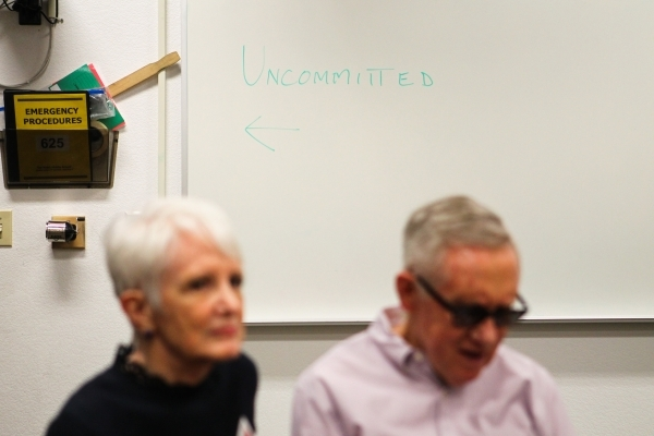 """U.S. Sen. Harry Reid, D-Nev., right, with his wife, Landra, sit in the """"uncommitted"""" voter area for their local precinct during Democratic caucus day at Del Webb Middle School in Henders ..."""