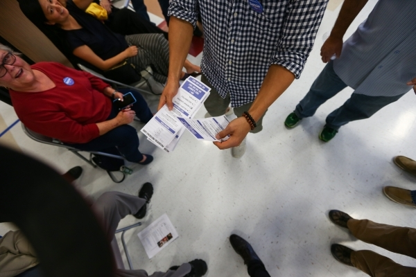 Supporters of Democratic presidential candidate Sen. Bernie Sanders, I-Vt., gather their cards to in a local precinct at Del Webb Middle School in Henderson on Saturday, Feb. 20, 2016. Chase Steve ...