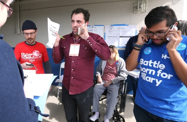Todd Sorensen, with the Bernie Sanders campaign, from left, Precinct Chair Scott Baez and Ben Mendez, site leader for Hillary Clinton, work to clarify the caucus count during the Democratic Caucus ...