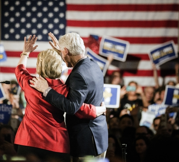 Democratic presidential candidate Hillary Clinton  and her husband former president Bill Clinton wave at supporters during a victory party at Caesars Palace on Saturday, Feb.20, 2016. Jeff Scheid/ ...