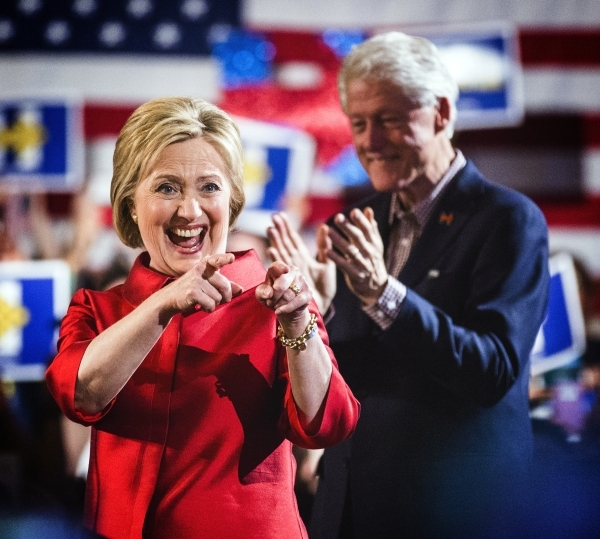 Democratic presidential candidate Hillary Clinton,left,  and her husband former president Bill Clinton celebrate with supporters during a victory party at Caesars Palace on Saturday, Feb.20, 2016. ...