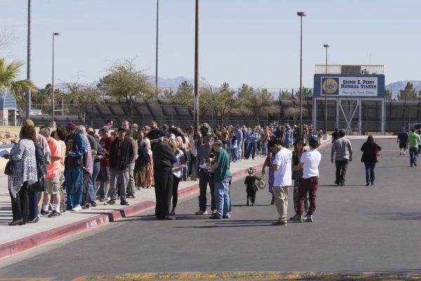 Democratic caucus participants wait in line to register at Cheyenne High School at 3200 W. Alexander Road in North Las Vegas Saturday, Feb. 20, 2016. Delegates were elected to the county conventio ...