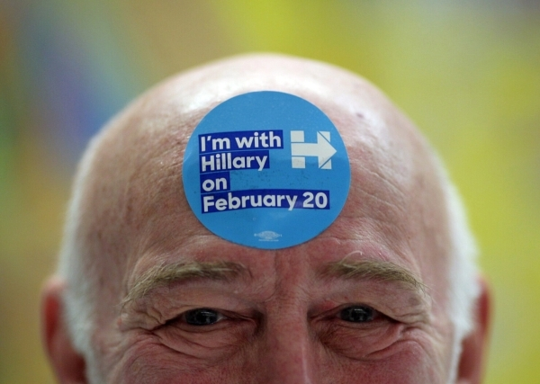 Norman Robinovitz, precinct 7712 captain, wears a sticker for Hillary Clinton on his forehead during the Democratic Caucus at David M. Cox Elementary School on Saturday, Feb. 20, 2016. Brett Le Bl ...