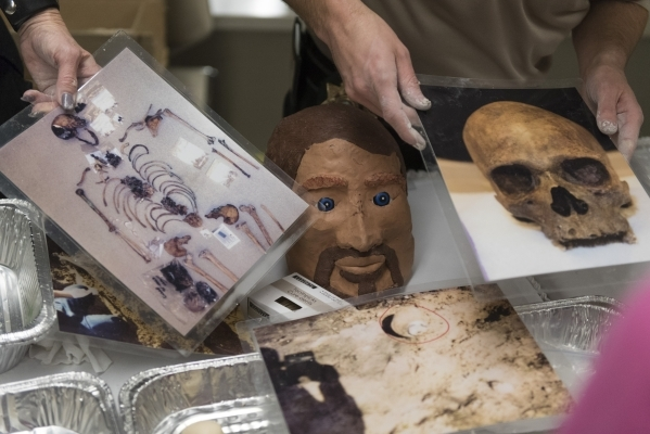 Suzanne Miele, forensic pathologist technician, left, and Scott Lawtzenheiser, forensic investigator with the Clark County Office of the Coroner/Medical Examiner, show crime scene evidence to atte ...