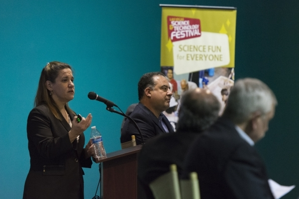 """Lisa Gavin, medical examiner with the Clark County Office of the Coroner/Medical Examiner, left, speaks during the Forensics Day  """"Demystifying the Forensic Sciences"""" panel at the Las Ve ..."""