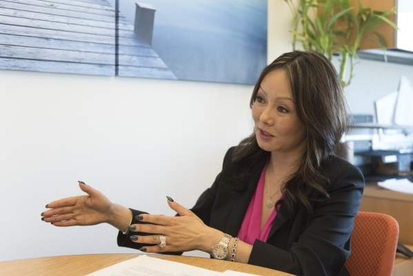Senior cirector of clinical research Dr. Kate Zhong speaks with a reporter at the Cleveland Clinic Lou Ruvo Center for Brain Health in Las Vegas, Thursday, Feb. 18, 2016. The clinic is recruiting  ...
