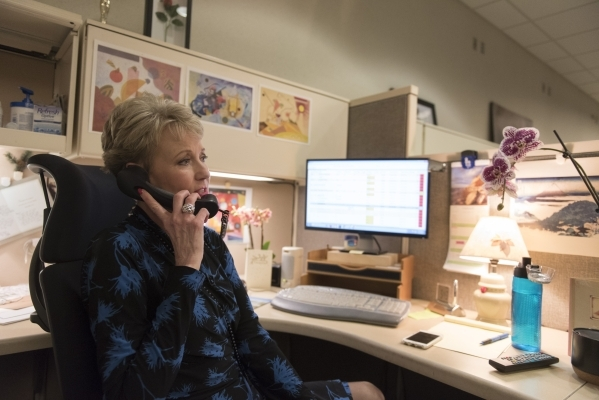 News anchor Paula Francis takes a phone call at her desk in the newsroom at KLAS-TV Channel 8's studio in Las Vegas Wednesday, Feb. 17, 2016. Francis will retire on April 1 after working in  ...