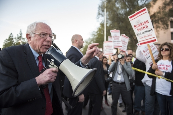 Democratic presidential candidate Bernie Sanders, I-Vt., left, speaks to the members of the Health Services Coalition as they picket at Sunrise Hospital in Las Vegas on Thursday, Feb. 18, 2016. Me ...
