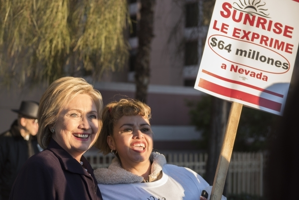 Democratic presidential candidate Hillary Clinton, left, takes a photo with a member of the Health Services Coalition as they picket at Sunrise Hospital in Las Vegas on Thursday, Feb. 18, 2016. Me ...