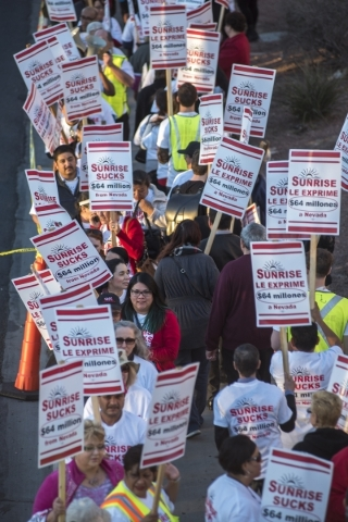 Health Services Coalition members picket at Sunrise Hospital in Las Vegas on Thursday, Feb. 18, 2016. Members protested and voiced their displeasure toward Hospital Corporation of America, which o ...
