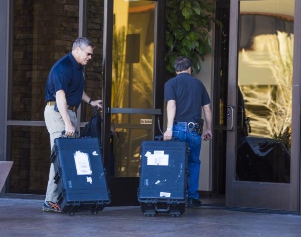 Law enforcement personnel enter a building at 8880 Sunset Road on Thursday, Feb. 18, 2016. Jeff Scheid/Las Vegas Review-Journal Follow @jlscheid