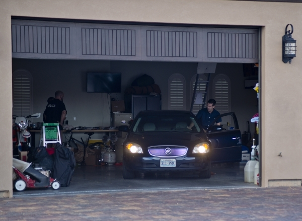 People are seen during an FBI raid at the home of Fredrick (Rick) J. Zaffarese-Leavitt in the 600 block of Du Fort Avenue in Henderson on Thursday, Feb. 18, 2016. Leavitt has been financial manage ...