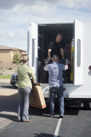 People load boxes into a law enforcement vehicle at the home of Fredrick (Rick) J. Zaffarese-Leavitt in the 600 block of Du Fort Avenue in Henderson is seen during a FBI raid Thursday, Feb. 18, 20 ...