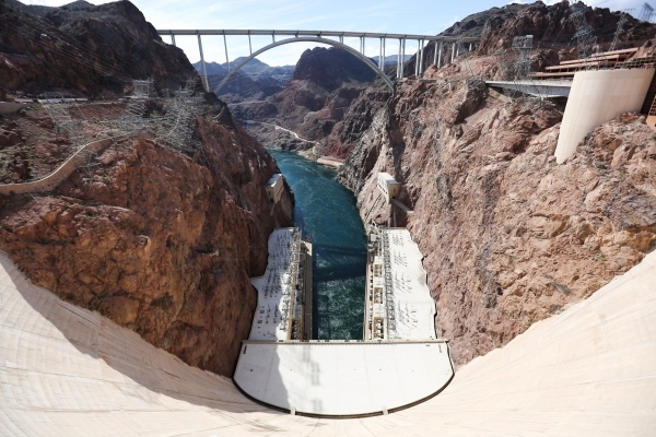 Power line towers lean out of cliffs on the left and right side of the Colorado river near the Hoover Dam outside of Boulder City, Nev., on Thursday, Feb. 18, 2016. Brett Le Blanc/Las Vegas Review ...
