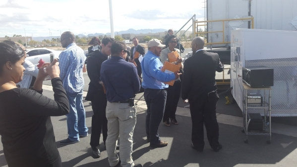 Guests of Thursday's local unveiling of the Solar Cold Box talk with representatives of Aldelano Corp. in the parking lot of the Switch Innevation Center in Las Vegas on Feb. 18, 2016.  Rich ...