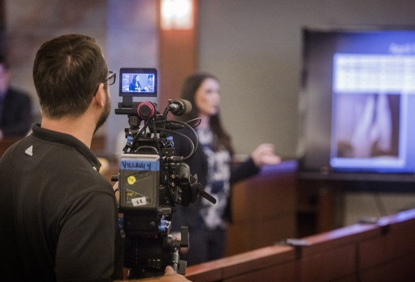 A videographer with Las Vegas D.A. docudrama films while Clark County prosecutor Elizabeth Mercer makes her opening statements in the  murder trial of defendant Bobby Richards at Regional Justice  ...