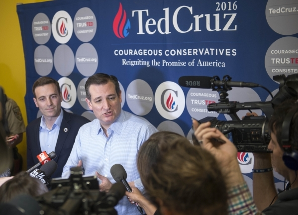 Nevada Attorney General Adam Laxalt, left, and Republican presidential candidate Sen. Ted Cruz of Texas speak with members of the news media before a rally at Draft Picks Sports Bar in Pahrump on  ...