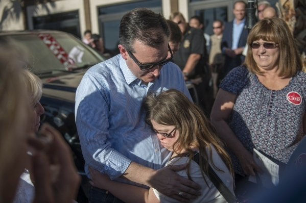 Republican presidential candidate Sen. Ted Cruz of Texas gets a hug from supporter Cinthia Nelson during a rally at Draft Picks Sports Bar in Pahrump on Sunday, Feb.  21, 2016. Nevada holds its Re ...