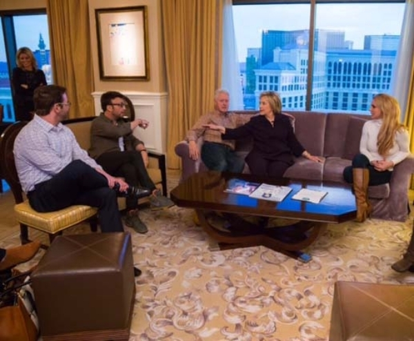 Hillary Clinton gestures during a conversation with Britney Spears' manager Larry Rudolph on Thursday in Clinton's suite at Caesars Palace. Spears on couch, right. Her brother Bryan Sp ...