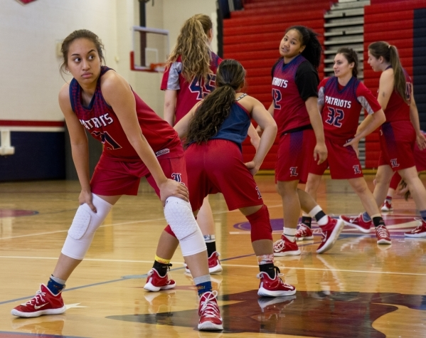 Liberty's Kaily Kaimikaua (21) stretches during practice at Liberty High School in Las Vegas on Tuesday, Feb. 23, 2016. Daniel Clark/Las Vegas Review-Journal Follow @DanJClarkPhoto