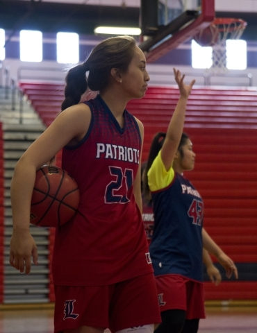 Liberty's Kaily Kaimikaua (21) looks over the court during practice at Liberty High School in Las Vegas on Tuesday, Feb. 23, 2016. Daniel Clark/Las Vegas Review-Journal Follow @DanJClarkPhoto