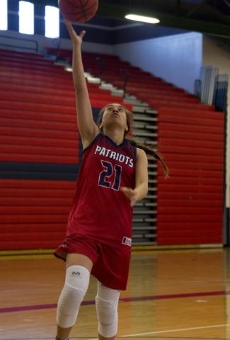 Liberty's Kaily Kaimikaua (21) takes the ball to the basket during practice at Liberty High School in Las Vegas on Tuesday, Feb. 23, 2016. Daniel Clark/Las Vegas Review-Journal Follow @DanJC ...