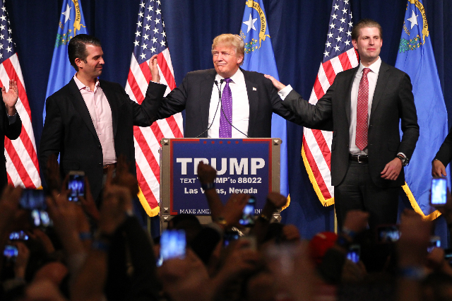 Republican presidential candidate Donald Trump, flanked by sons Donald Trump Jr., left, and Eric Trump, speaks at his watch party at Treasure Island hotel-casino in Las Vegas on Tuesday, Feb. 23,  ...