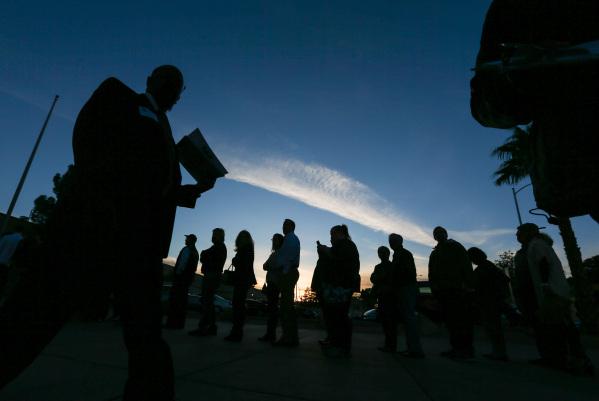 Republican caucus-goers arrive at Bonanza High School in Las Vegas on Tuesday, Feb. 23, 2016. Chase Stevens/Las Vegas Review-Journal Follow @csstevensphoto