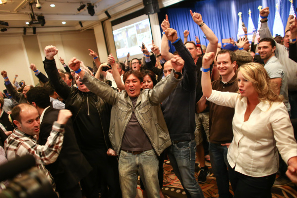Supporters celebrate as numbers come in projecting Republican presidential candidate Donald Trump as the winner of the Nevada GOP caucus at Trump's watch party at Treasure Island hotel-casin ...