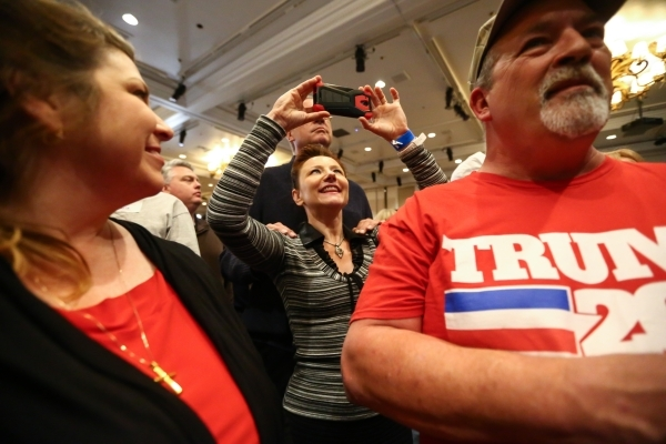 Supporters react as numbers come in projecting Republican presidential candidate Donald Trump as the winner of the Nevada GOP caucus at Trump's watch party at Treasure Island hotel-casino in ...