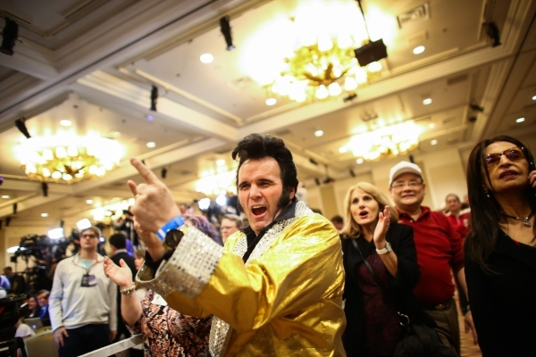 An Elvis impersonator reacts as numbers come in projecting Republican presidential candidate Donald Trump as the winner of the Nevada GOP caucus at Trump's watch party at Treasure Island hot ...