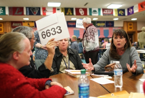 Republican caucus-goer MaryJane Eichholz, right, voices her support for Republican presidential candidate Ted Cruz at Bonanza High School in Las Vegas on Tuesday, Feb. 23, 2016. Chase Stevens/Las  ...