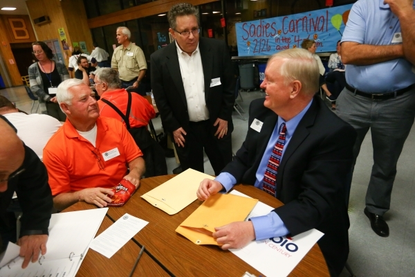 Caucus-goers, from left Clay Werts, Stephen Kopolow and Bill Harrington discuss Republican presidential candidates at Bonanza High School in Las Vegas on Tuesday, Feb. 23, 2016. Chase Stevens/Las  ...
