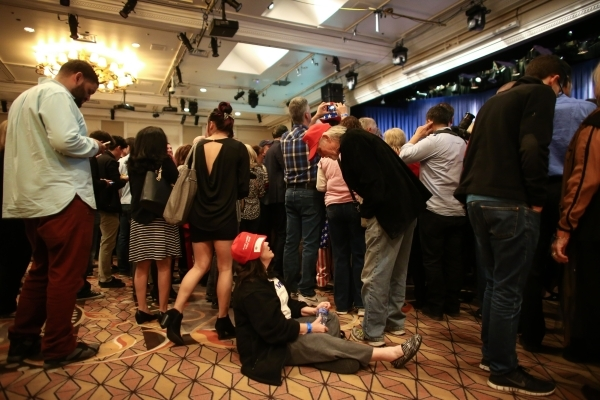 Supporters of Republican presidential candidate Donald Trump wait for numbers to come in for the Nevada GOP caucus at Trump's watch party at Treasure Island hotel-casino in Las Vegas on Tues ...