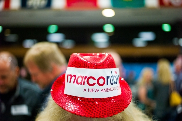Carol Tanner, a supporter of Republican presidential candidate Marco Rubio shows off her hat as caucus-goers arrive at Bonanza High School in Las Vegas on Tuesday, Feb. 23, 2016. Chase Stevens/Las ...