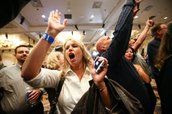 Michelle Creech celebrates with others as numbers come in projecting Republican presidential candidate Donald Trump as the winner of the Nevada GOP caucus at Trump's watch party at Treasure  ...