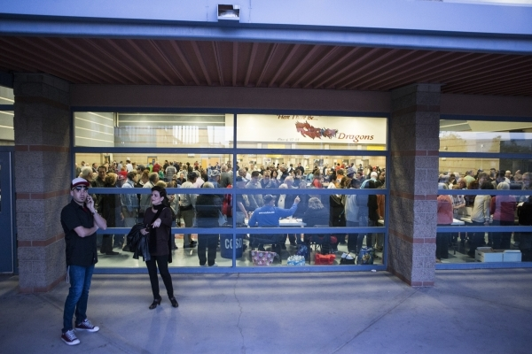 People stand outside of the Del Sol High School cafeteria where people participated in the Nevada Republican caucus on Tuesday, Feb. 23, 2016, in Las Vegas. Erik Verduzco/Las Vegas Review-Journal  ...