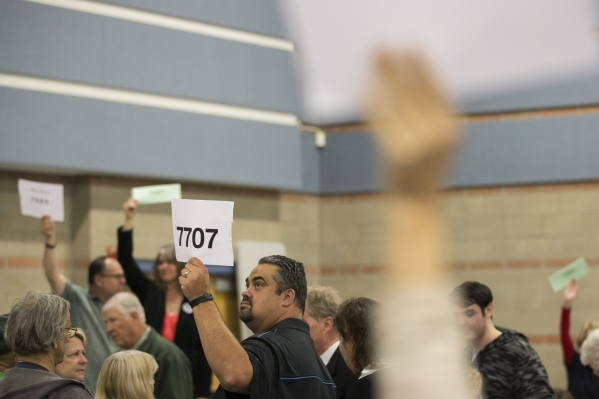Joe Monsour holds up  a sign with his prescient number during the Nevada Republican caucus at Del Sol High School on Tuesday, Feb. 23, 2016, in Las Vegas. Erik Verduzco/Las Vegas Review-Journal Fo ...