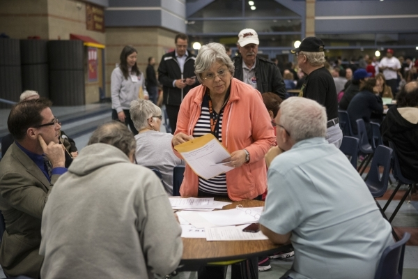 Information volunteer Jeannie Brewer answers questions during the Nevada Republican caucus at Del Sol High School on Tuesday, Feb. 23, 2016, in Las Vegas. Erik Verduzco/Las Vegas Review-Journal Fo ...