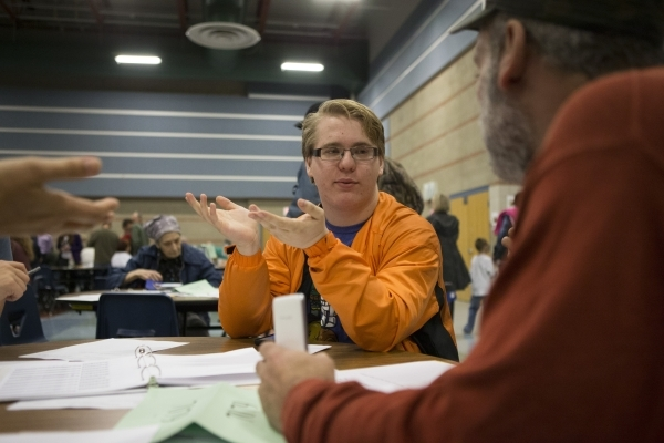 Kevin Tyler discusses the confusion with the voting process during the Nevada Republican caucus at Del Sol High School on Tuesday, Feb. 23, 2016, in Las Vegas. Erik Verduzco/Las Vegas Review-Journ ...